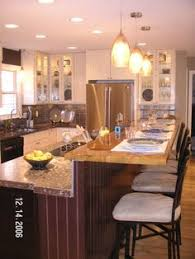raised kitchen island the large open kitchen with adjoining breakfast area includes an