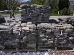 pallets of stone flagstone boulders cobblestone delivery