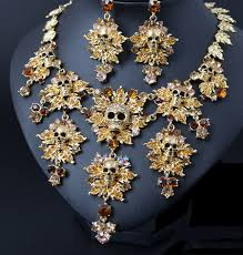 rhinestone necklace earrings images Trendy rhinestone skull necklace earrings set in gold jpg