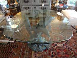 dolphin table with glass top patinated bronze triple dolphin center table with glass top at 1stdibs