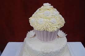 giant wedding cakes giant wedding cupcake cake topper