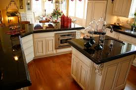 Black And Brown Kitchen Cabinets by Alluring Cream Kitchen Cabinets With Black Countertops