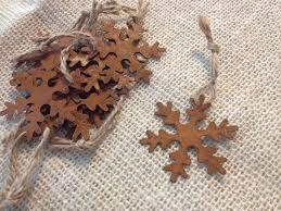 set of 10 miniature metal snowflake ornaments rust brown
