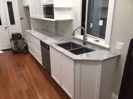 Stone Backsplashes For Kitchens by Granite Countertop Cream Shaker Kitchen Doors Stacked Stone