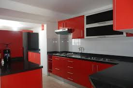 modern red kitchen design with black backsplash and white tile