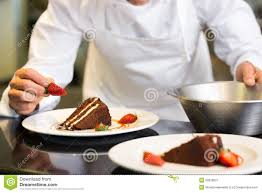 Chef Decor For Kitchen by Mid Section Of Pastry Chef Decorating Dessert Stock Photo Image
