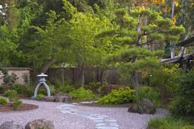 minimal small japanese gardens with elegant use of rock and sand