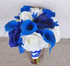 blue lilies touch open white and blue roses bouquet