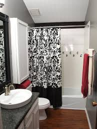 black and white bathroom shower curtain white countertop sink