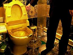 trumps apartment chair made out of gold plated ak 47s boing boing boing bbs