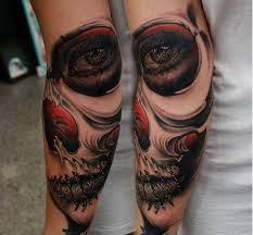 black skull on shoulder tattoomagz