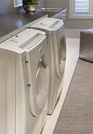 table over washer and dryer diy laundry room countertop over washer dryer removeandreplace com
