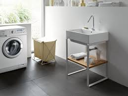 Laundry Room Sinks by Simple Laundry Sink Design With Towel Storage Underneath Along