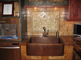copper farmhouse sink and copper tile backsplash copper sink