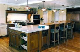 two level kitchen island kitchen with white cabinets and grey island tag kitchen cabinets