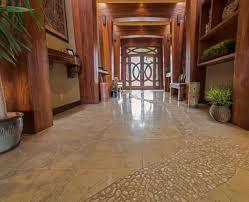 travertine floor with pebble pathway suva tile