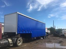 curtain side tarp install in edmonton alberta by maverick trailer
