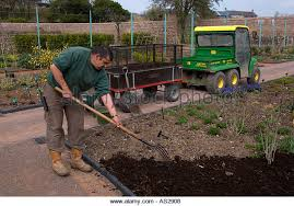 gardener working in walled garden stock photos u0026 gardener working