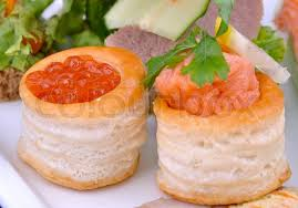 pate canapes canape with salmon caviar and pate of salmon on a plate stock
