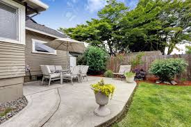 backyard patio area with table set and umbrella patio with