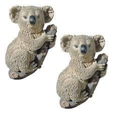 amazon com design toscano kouta the climbing koala sculpture