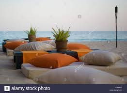 low seating set up on the beach at sunset at six senses zighy bay