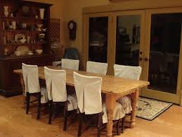 rustic dining room design with white dining chair covers
