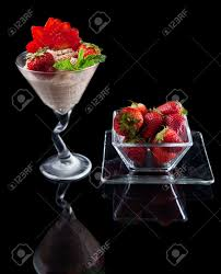chocolate mint martini strawberries and chocolate mousse in a chilled martini glass
