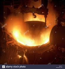 electric arc furnace receiving second charge of scrap metal an
