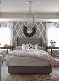 contemporary master bedroom with chandelier by justin huggins