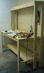workbench with pegboard and light how to build a workbench for your garage to get organized