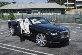 roll royce dawn black first rolls royce dawn gets forgiato wheels autoevolution