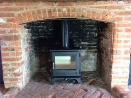 a chesney salisbury 5 kw stove in a gorgeous red brick fireplace