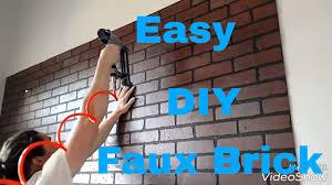 make a faux brick wall with brick panels diy interior design