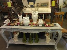 home decoration traditional table with owl statue and angelic