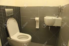 Modern Toilet by Modern Toilet In White And Different Shades Of Grey Stock Photo
