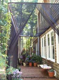 Mosquito Curtains Mosquito Curtains Make For Easy And Affordable Porch Enclosures