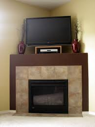 corner fireplace with tv on top fireplace design and ideas