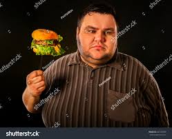 diet failure fat man eating fast stock photo 641337589 shutterstock