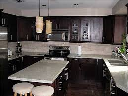 espresso kitchen cabinets with white countertops espresso kitchen the combination of cabinets and