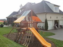 exterior outdoor playground design with natural green grass and