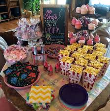 ready to pop baby shower favor table with things that go pop