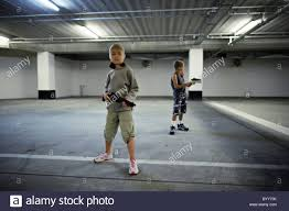 Car Park by Children With Stocking Masks And Toy Guns In Underground Carpark