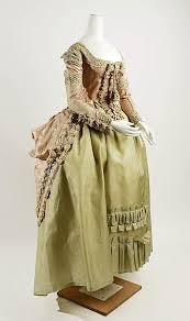 a 1770 80s silk brocade polonaise dress and a quilted silk