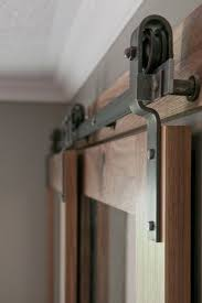 Sliding Barn Doors A Practical Solution For Large Or by Barn Door Hardware Bypass Doors On A Single Rail This Would