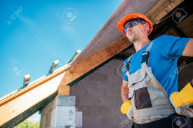 proud caucasian home builder contractor preparing for roof
