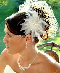 ivory birdcage veils with delicate hand made flower bridal veils
