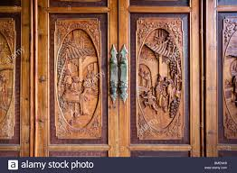 detail of wooden closet door carved with ancient stories lu u0027s