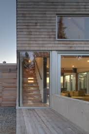 martin architects cedar shingles cascading down a modern courtyard house freshome com