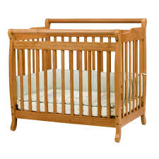 Davinci Mini Crib Mattress by Davinci Emily Mini Convertible Crib Oak Toys